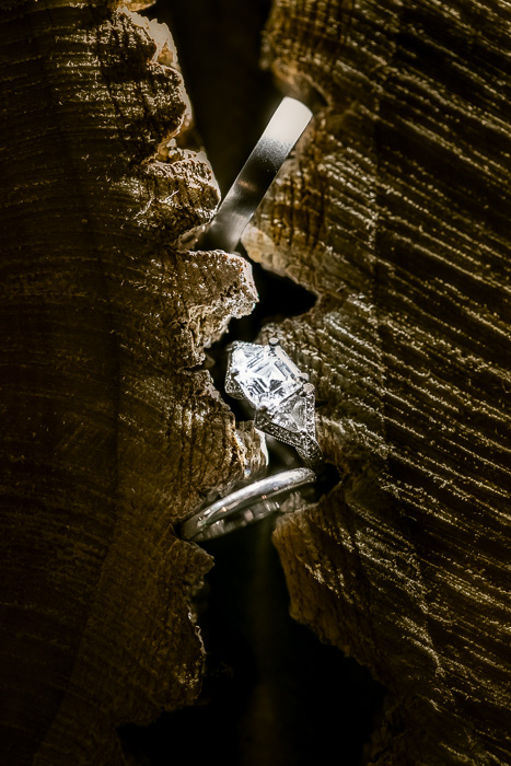 wedding rings trapped between wooden cogs