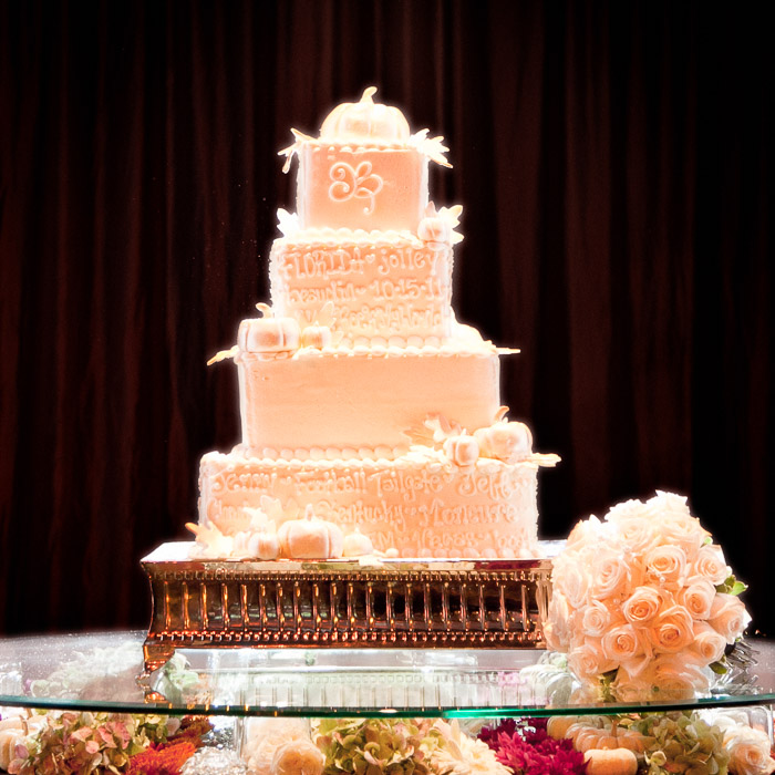 Wedding cake with the story of the couple written in icing around the cake.