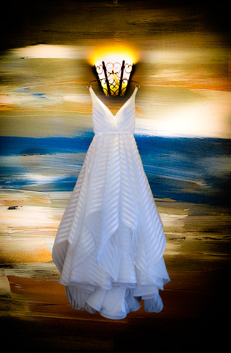 Stripped bridal gown on painted backgound