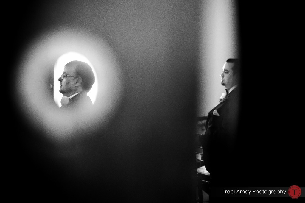interesting framing of groom and his father through door at their wedding at Millennium Center in Winston-Salem, NC.