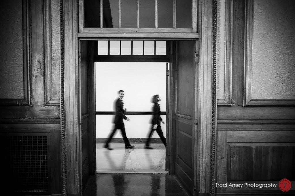 Beatles like image of groomsmen heading to historic courtroom at their wedding at Millennium Center in Winston-Salem, NC.