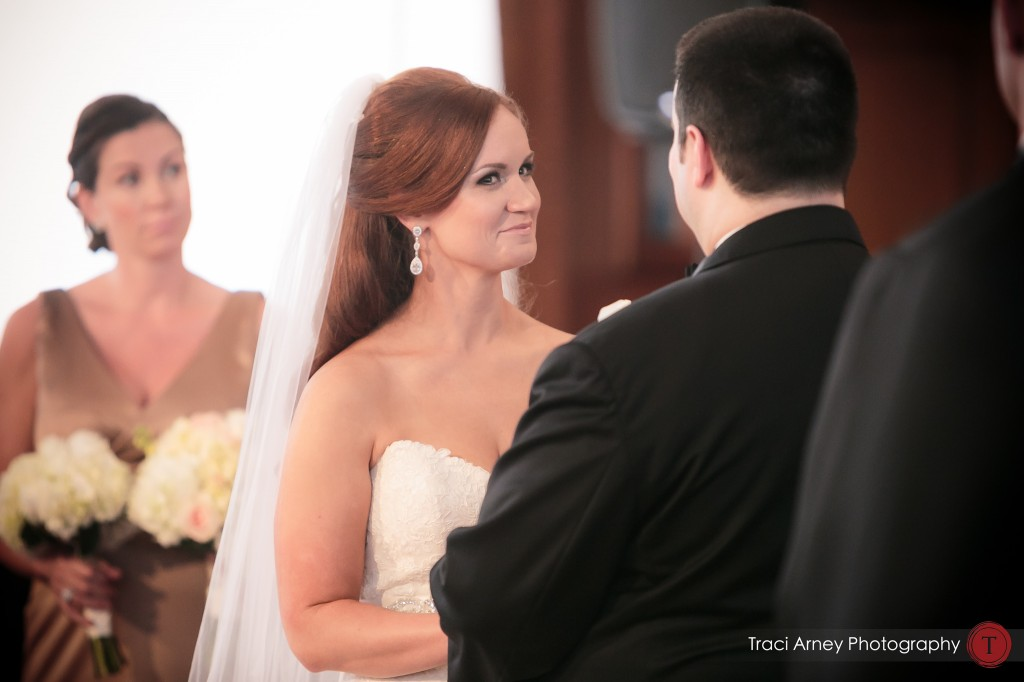 Bride gives funny look to her groom in historic courtroom where their ceremony at their wedding at Millennium Center in Winston-Salem, NC.