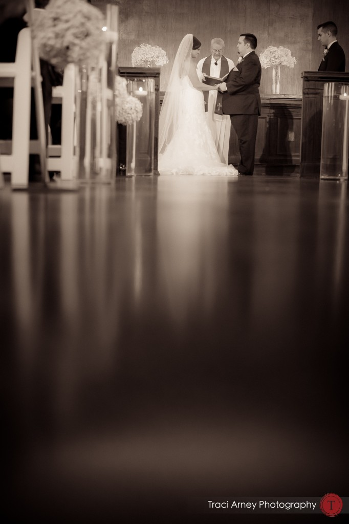 Shot of bride and groom during their ceremony in historic courtroom at their wedding at Millennium Center in Winston-Salem, NC.