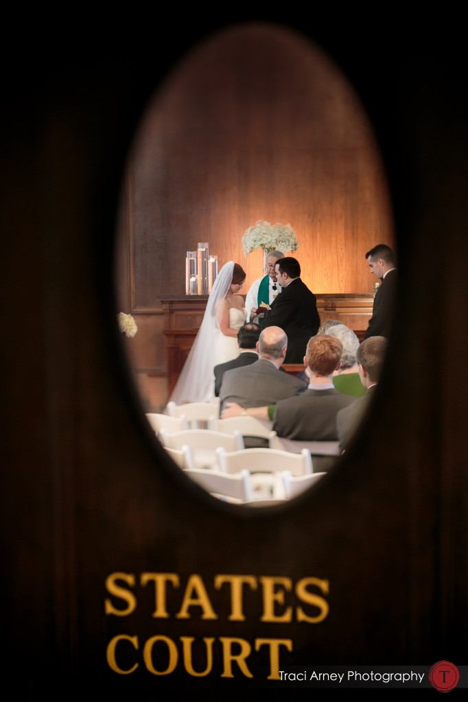 bride and groom framed through courtroom door at their wedding at Millennium Center in Winston-Salem, NC.