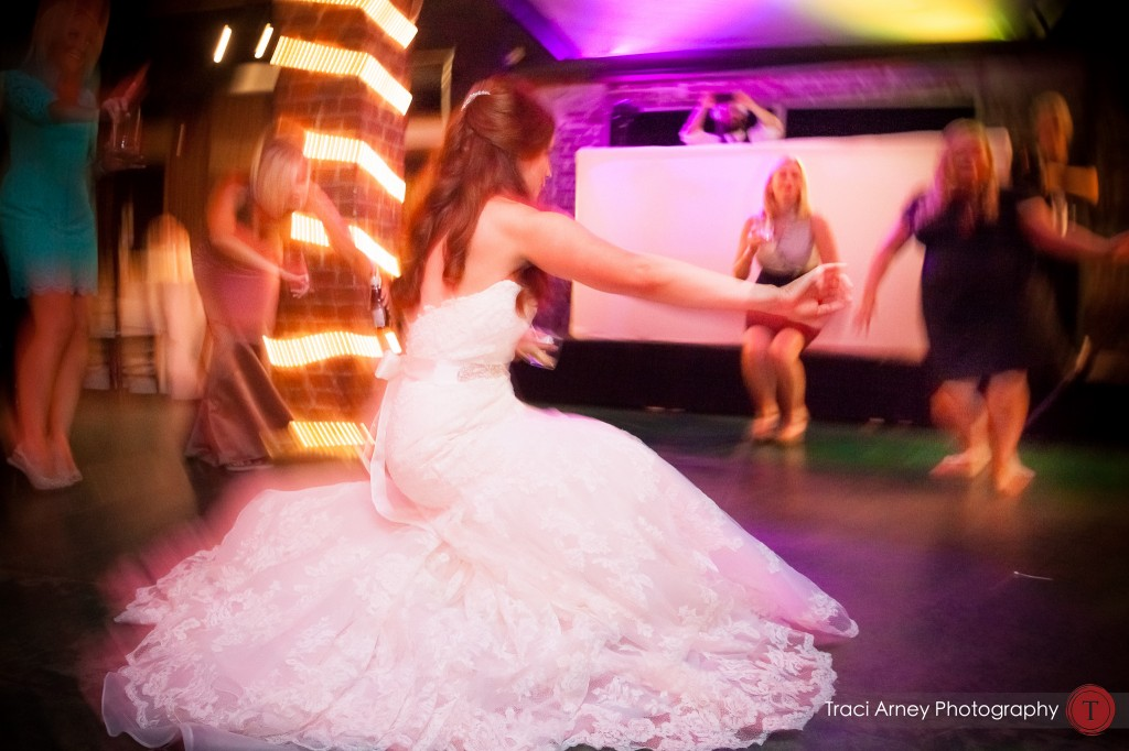 bride and groom and guests dance on the dance floor at their wedding at Millennium Center in Winston-Salem, NC.