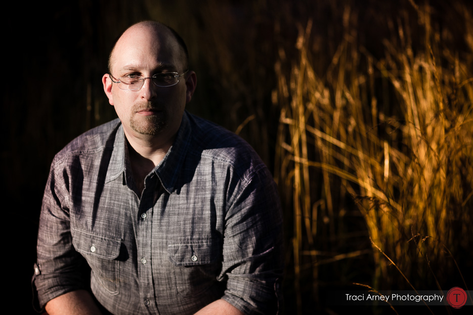 Engagement session in Greensboro, NC, groom in beautiful light with tall grass in background