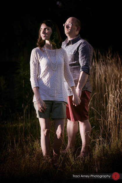 Engagement session in Greensboro, NC, bride and groom in beautiful light with tall grass in the background