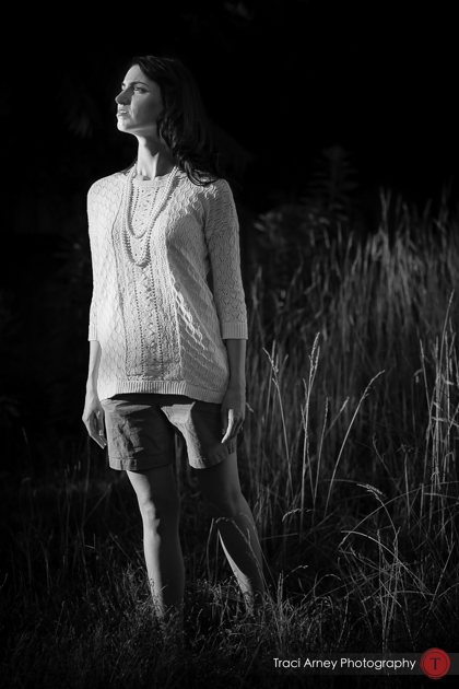 Engagement session in Greensboro, NC, black and white image of bride standing in beautiful light against a backdrop of tall grass