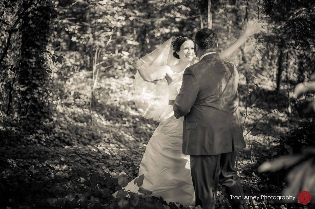 Bride reaching out to hug her groom during their first look from their campground wedding in Asheville, NC.
