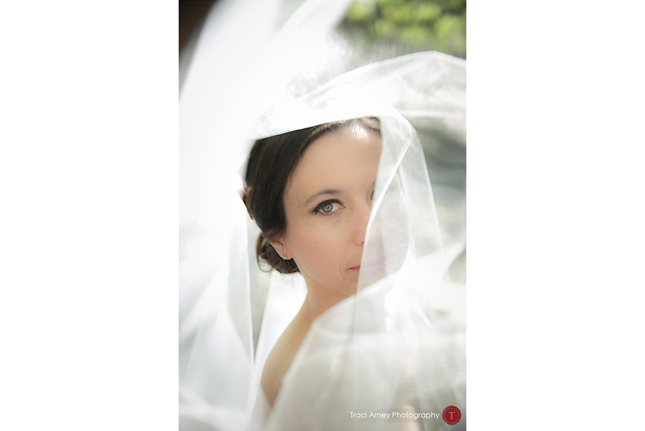 Color image of bride's face and eye through her veil during their campground wedding in Asheville, NC.