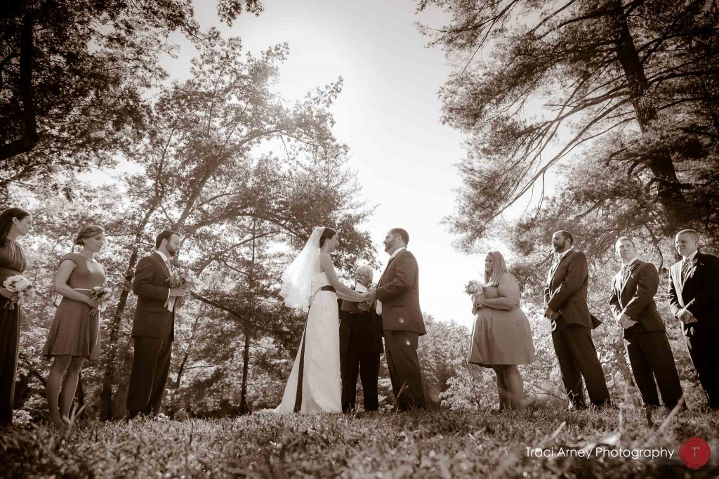 Sepia toned image of bride and groom in their outdoor ceremony during their campground wedding in Asheville, NC.