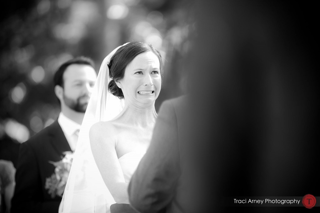 bride makes a comical grimace during their campground wedding in Asheville, NC.