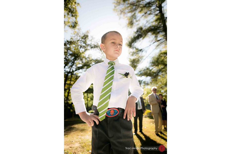 ring bearer wore his spiderman belt buckle for the wedding during their campground wedding in Asheville, NC.