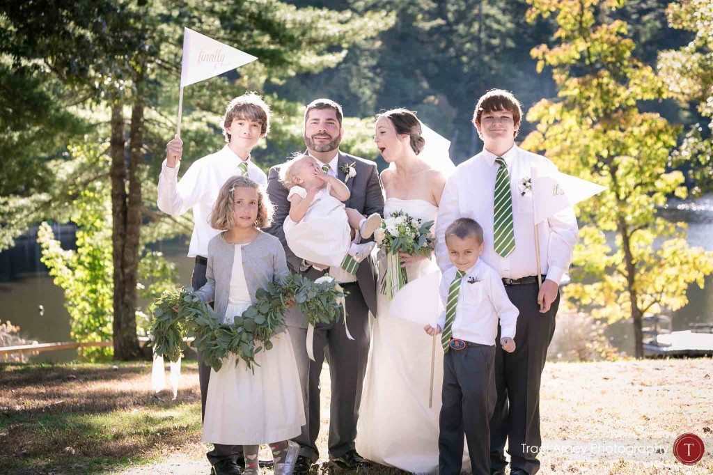 silly formal photo of bride and groom with all the kids in the wedding during their campground wedding in Asheville, NC.