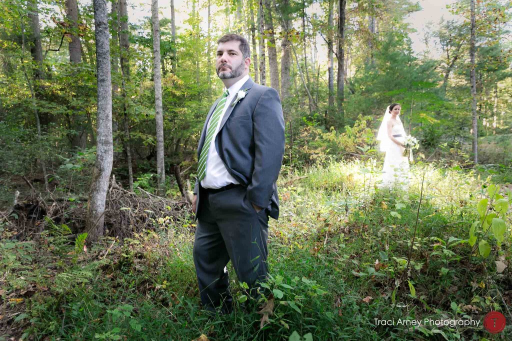 formal portrait of bride and groom in forest during their campground wedding in Asheville, NC.