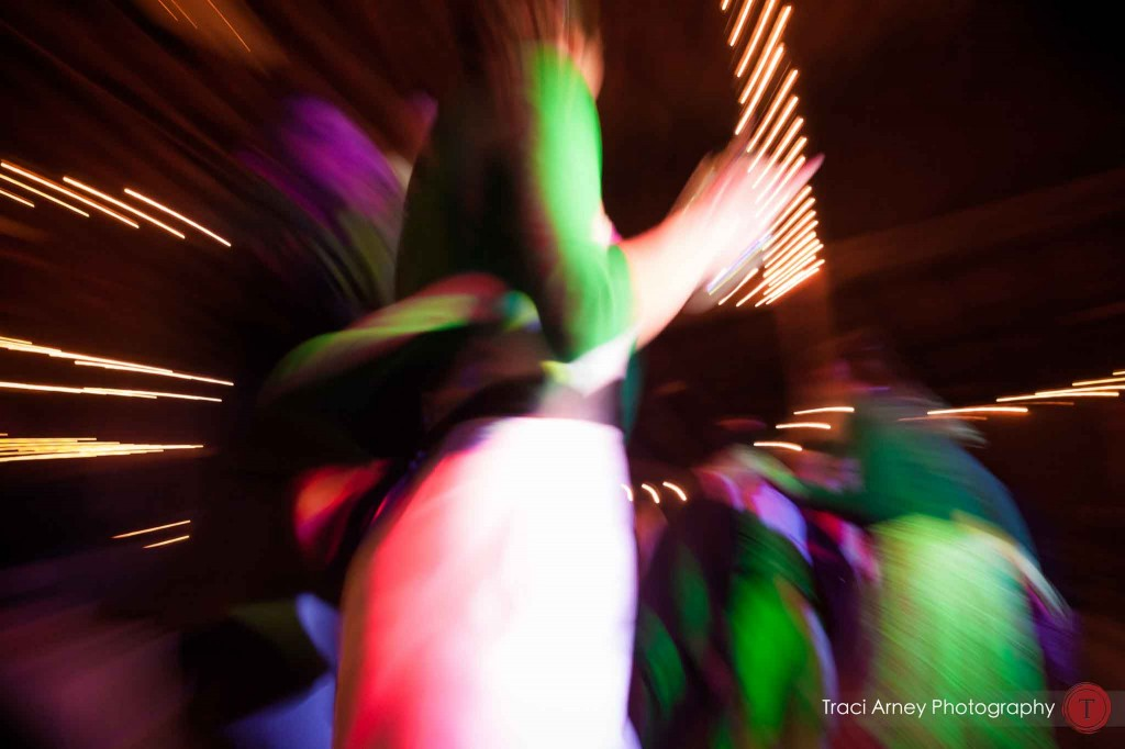 motion color image of bride dancing during their campground wedding in Asheville, NC.