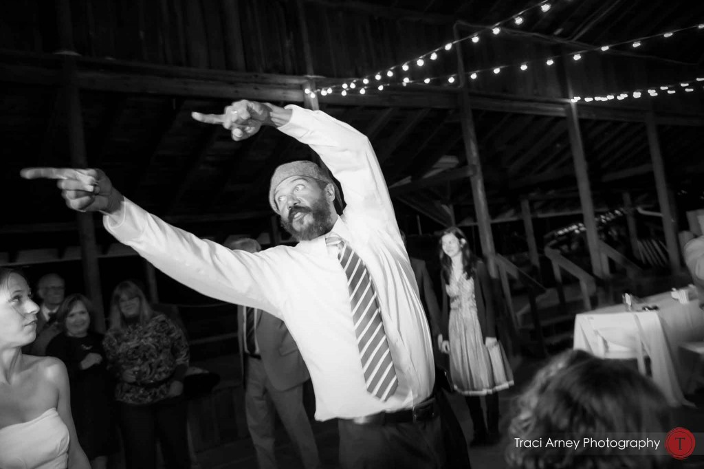 wedding guest making big gesture while dancing during their campground wedding in Asheville, NC.