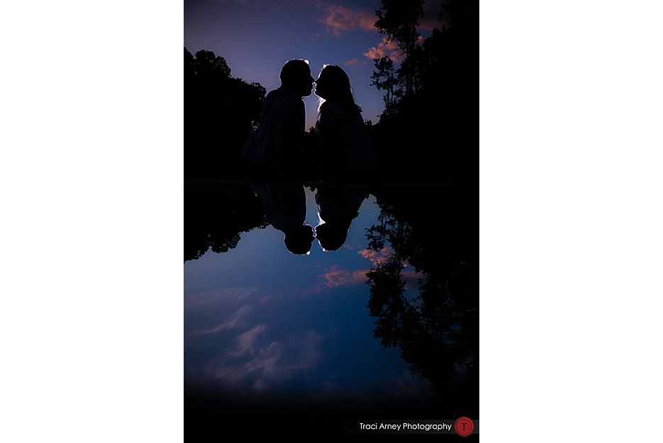 color portraits of silhouetted couple with reflection romantic from engagement session in lakeside Winston-Salem, NC by Traci Arney Photography