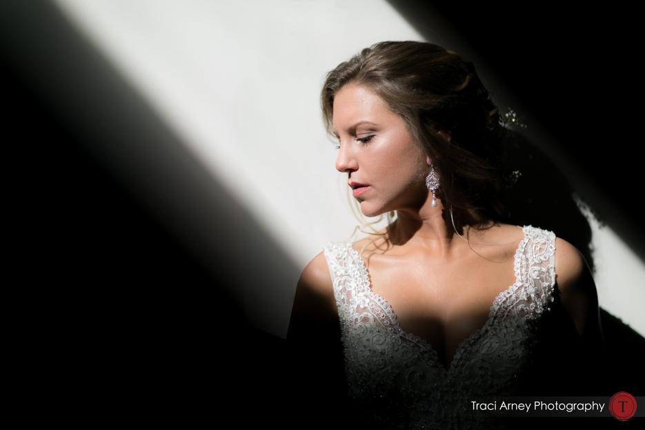 color portrait of bride in shaft of light. Revolution Mills wedding.