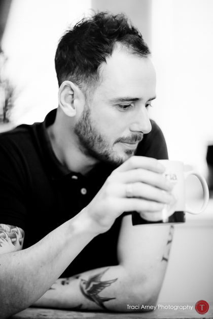 Editorial portrait of english groom drinking tea