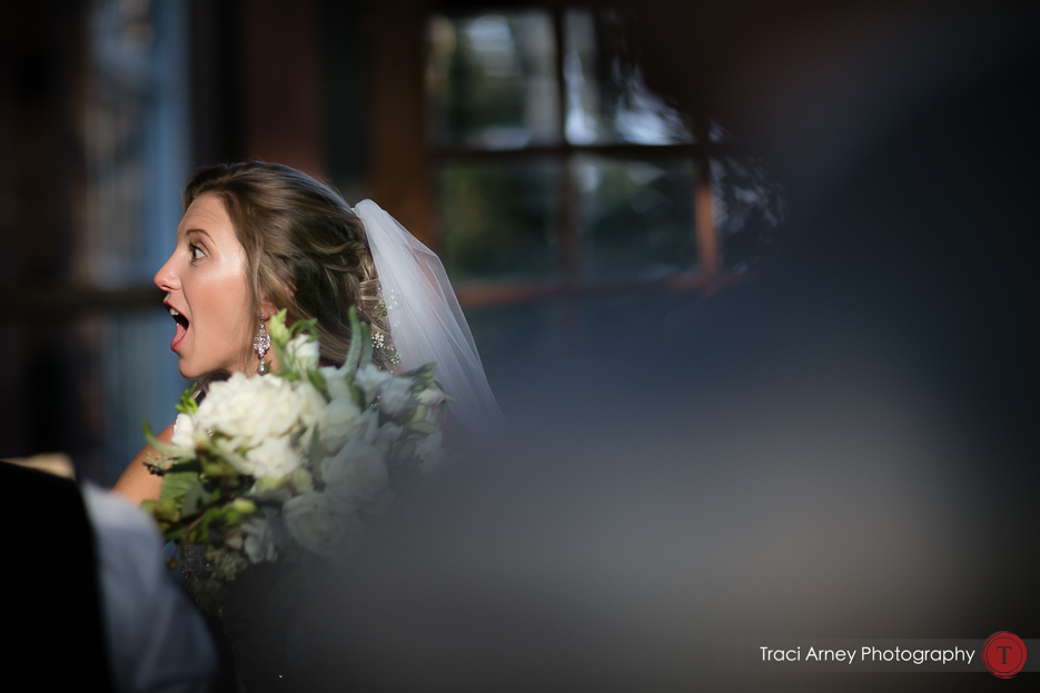 surprised look on bride's face after the wedding. Revolution Mills wedding.