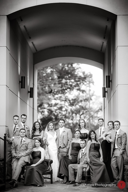 Vanity Fair style bridal party shot outdoors under arch in black and white. Revolution Mills wedding.