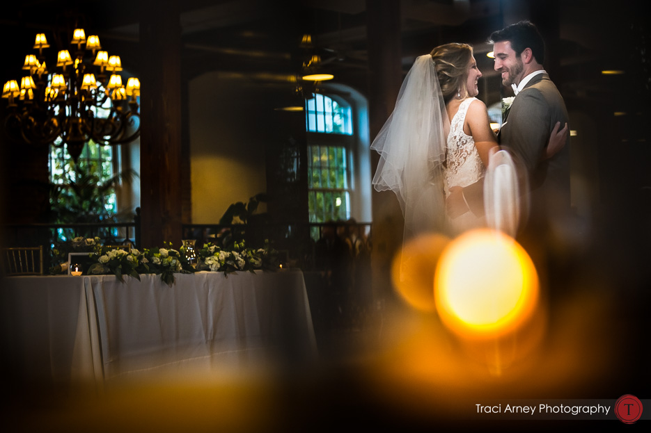 bride and groom's first dance through candles. Revolution Mills wedding.