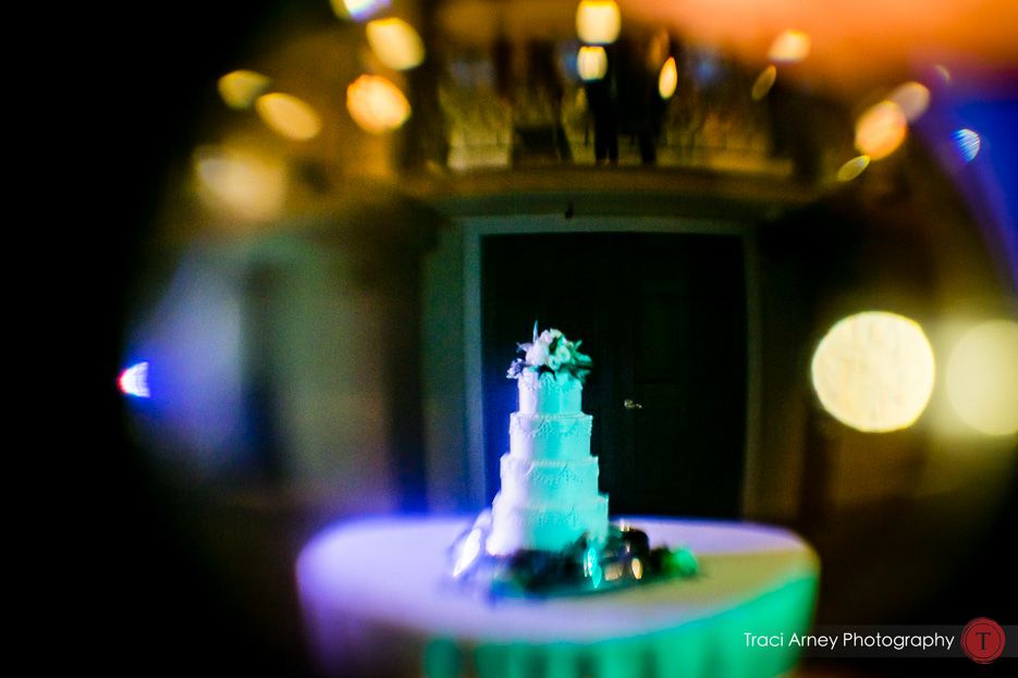 Creative cake shot with distortion and color washes. Revolution Mills wedding.