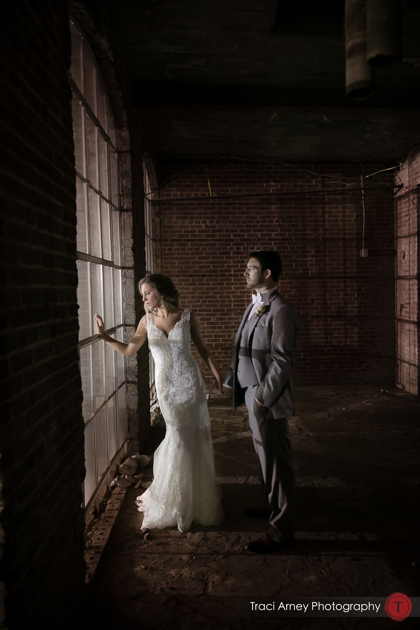Industrial shot of bride and groom during romance session. Revolution Mills wedding.