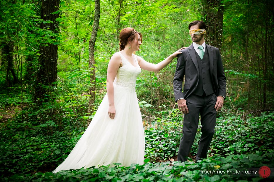 bride and groom in forest or their first look at Camp Pinnacle outdoor campground wedding in Asheville, NC