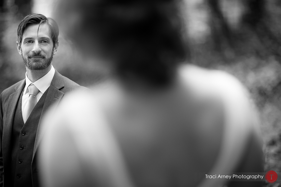 Black and white portrait of groom looking over his bride's shoulder at Camp Pinnacle outdoor campground wedding in Asheville, NC