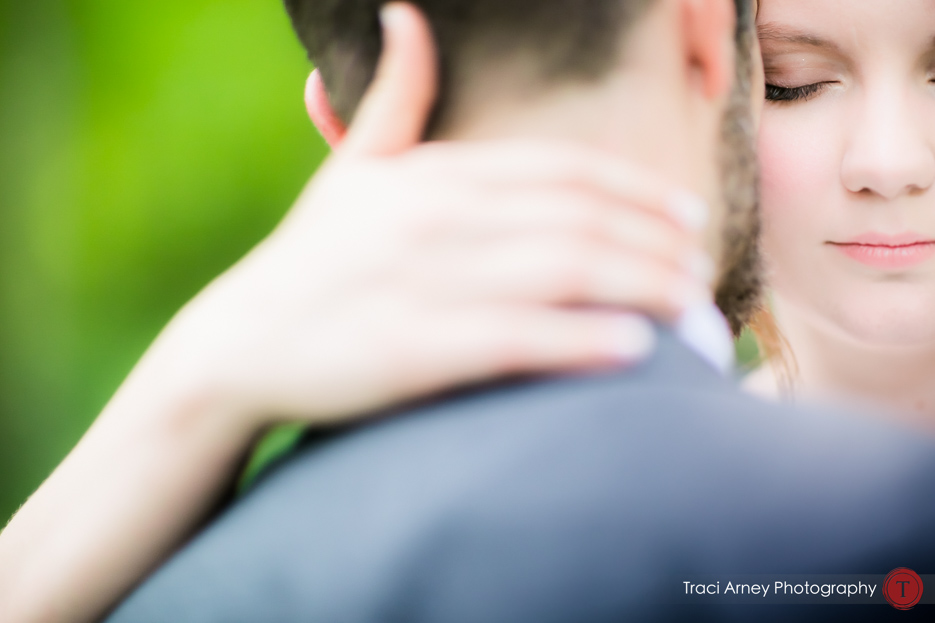 Intimate portrait of bride and groom embracing at Camp Pinnacle outdoor campground wedding in Asheville, NC