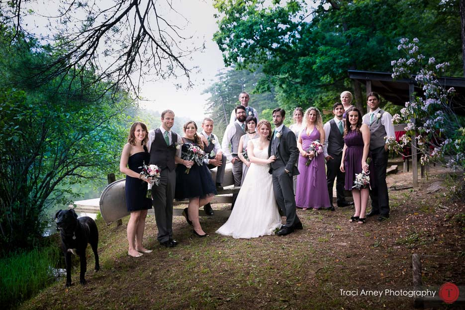 Colorful and eclectic bridal party portrait with dog and canoe at Camp Pinnacle outdoor campground wedding in Asheville, NC