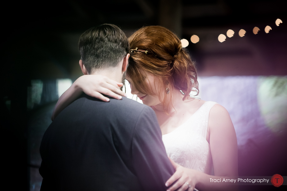 COlor image of bride and groom embracing on the dance floor at Camp Pinnacle outdoor campground wedding in Asheville, NC
