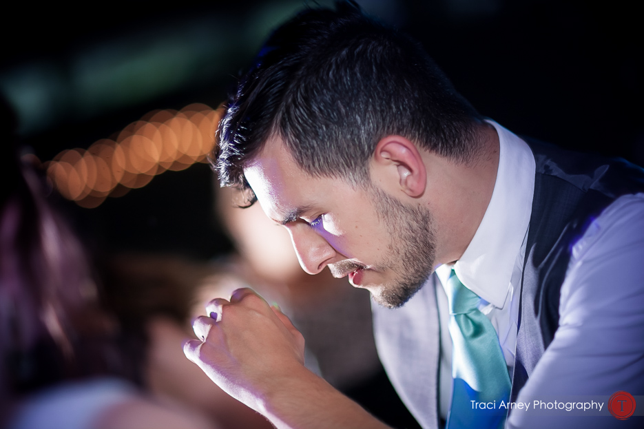 Guest dancing on colorfully lit dance floor at Camp Pinnacle outdoor campground wedding in Asheville, NC