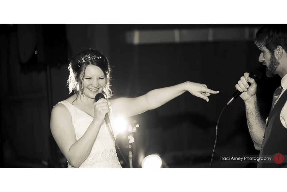 Bride sings karaoke during her reception at Camp Pinnacle outdoor campground wedding in Asheville, NC