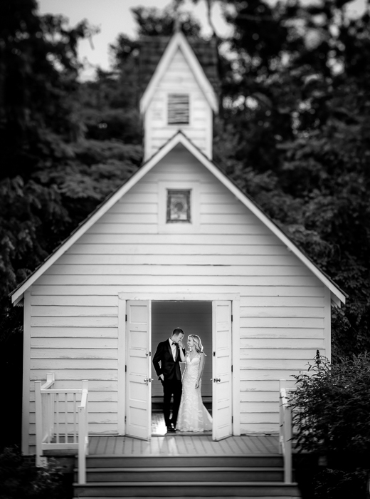 Little white chapel wedding portrait of bride and groom