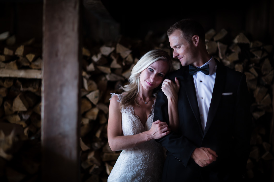 TV news personalities have a romance session wedding portrait in woodshed on the grounds of historic Old Salem NC